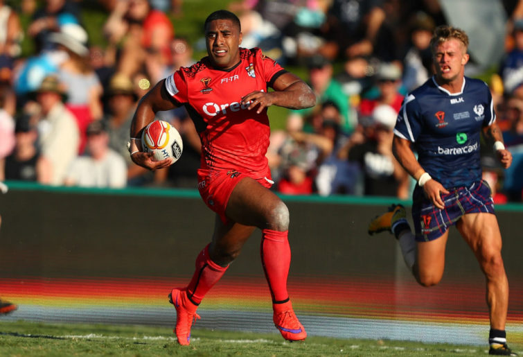 Michael Jennings makes a break for Tonga