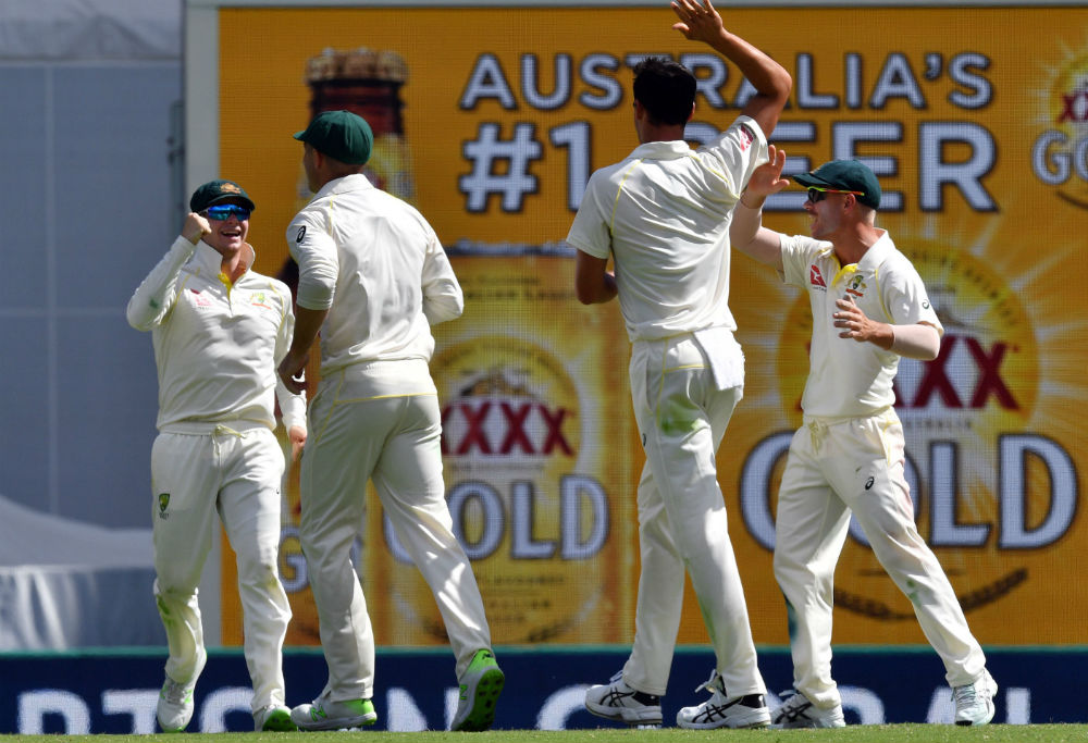 Steve Smith takes a catch during the Ashes