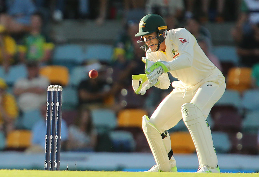 Australian wicket keeper Tim Paine looks to catch on Day 1 of the First Test match between Australia and England at the Gabba in Brisbane, Thursday, November 23, 2017.