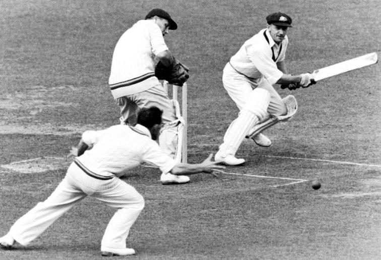 Australia's Don Bradman (r) batting