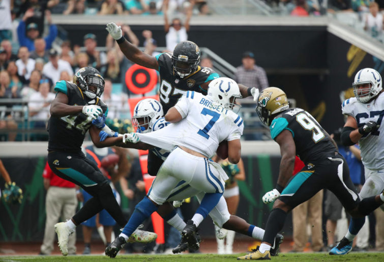 JACKSONVILLE, FL - DECEMBER 03: Jacoby Brissett #7 of the Indianapolis Colts is pressured by a group of Jacksonville Jaguars defenders in the second half of their game at EverBank Field on December 3, 2017 in Jacksonville, Florida.