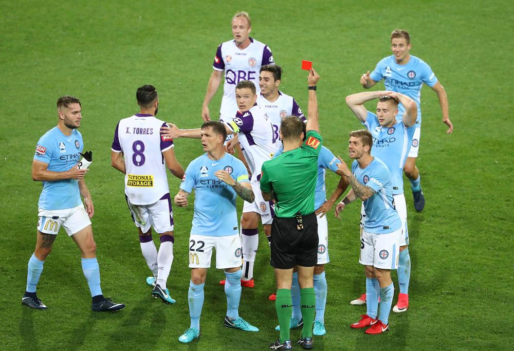 Referee Daniel Elder gives Osama Malik of the City a red card