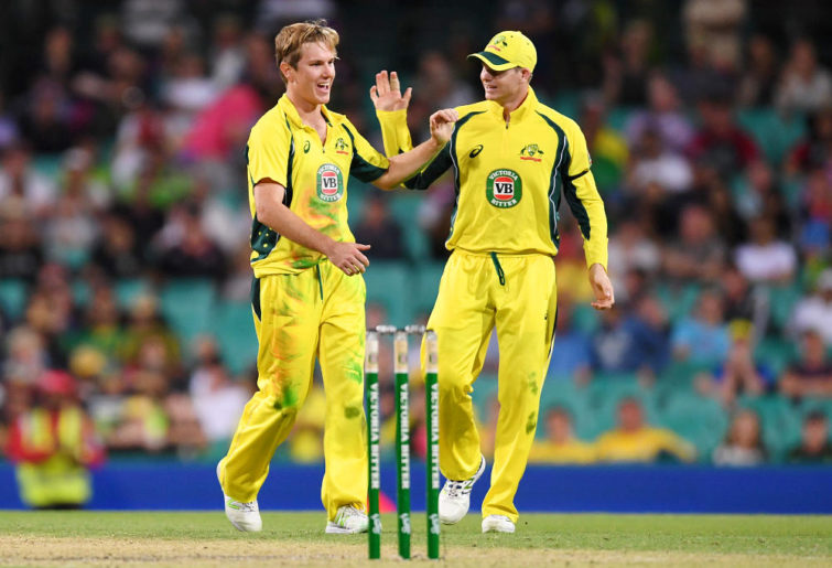 Adam Zampa celebrates with Steve Smith