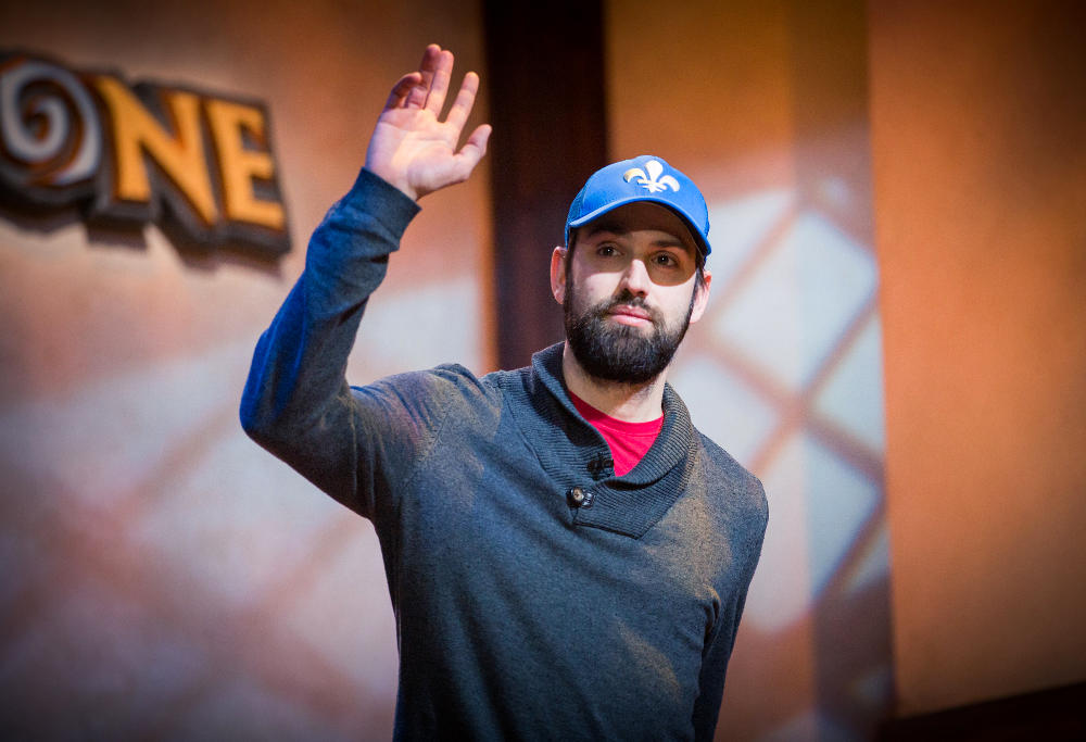"""Julien """"DocPwn"""" Bachand, of Canada, salutes the crowd at the Hearthstone Championship Tour in Amsterdam."""