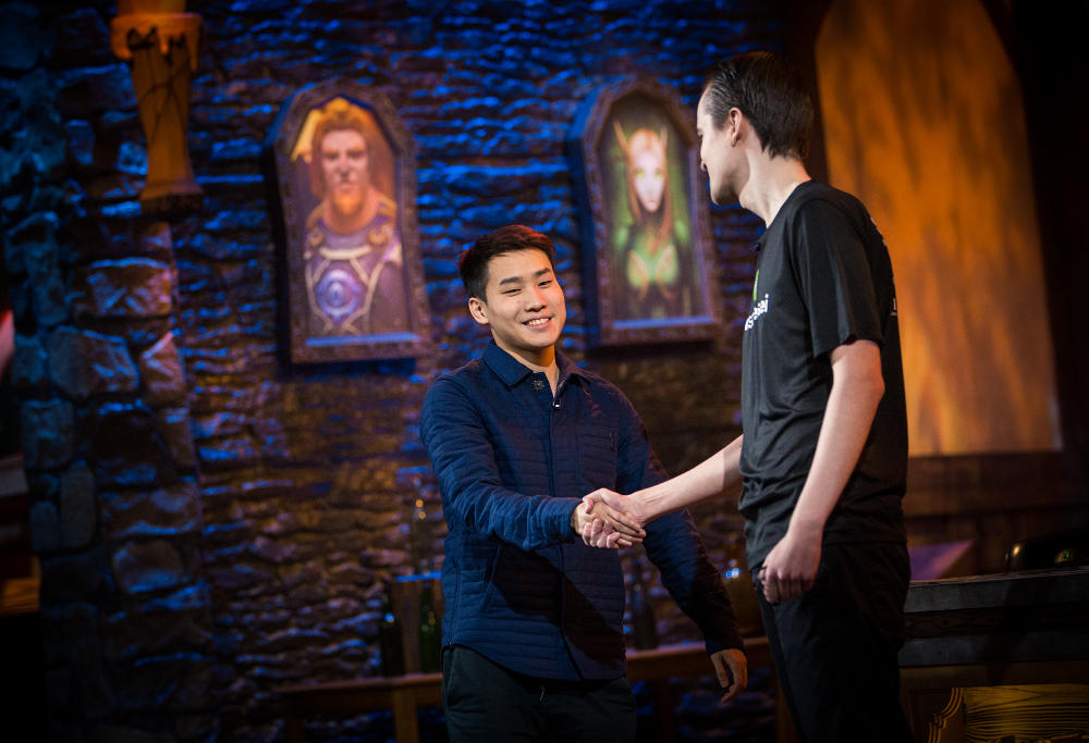 """Hearthstone players Frakn """"Fr0zen"""" Zhang and Tom """"Sintolol"""" Zimmer shake hands after their quarterfinal at the Hearthstone Championship Tour event in Amsterdam."""