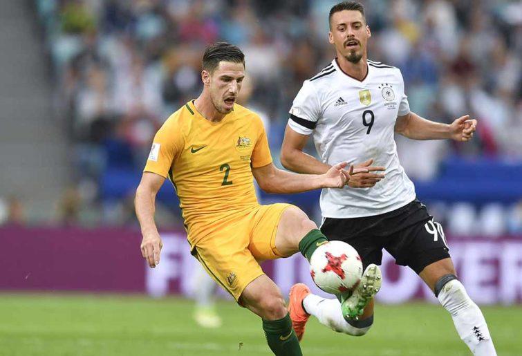 Milos Degenek goes for the ball