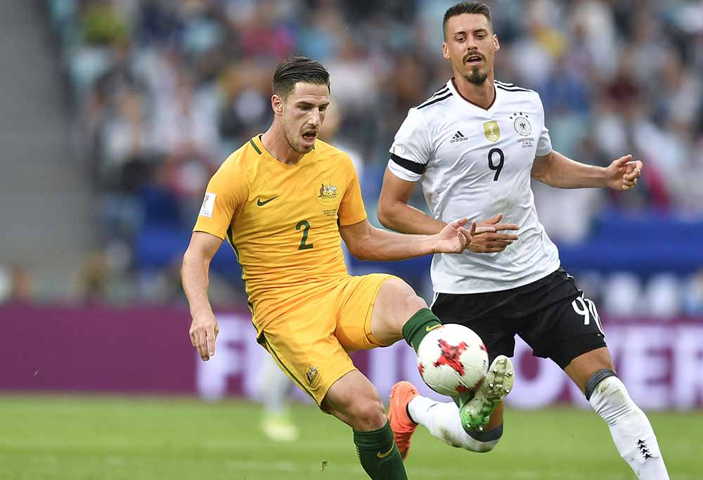 Milos Degenek goes for the ball