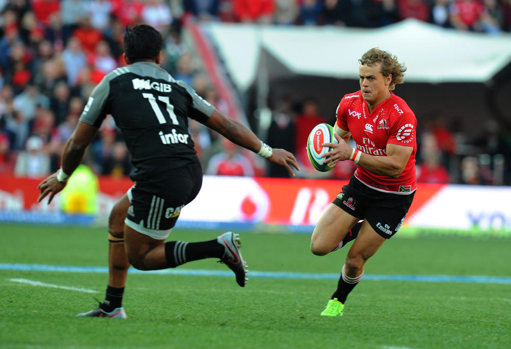 JOHANNESBURG, SOUTH AFRICA - AUGUST 05: Andries Coetzee of Lions is tackled by Seta Tamanivalu of Crusaders lduring the Super Rugby Final match between Emirates Lions and Crusaders at Emirates Airline Park on August 05, 2017 in Johannesburg, South Africa.