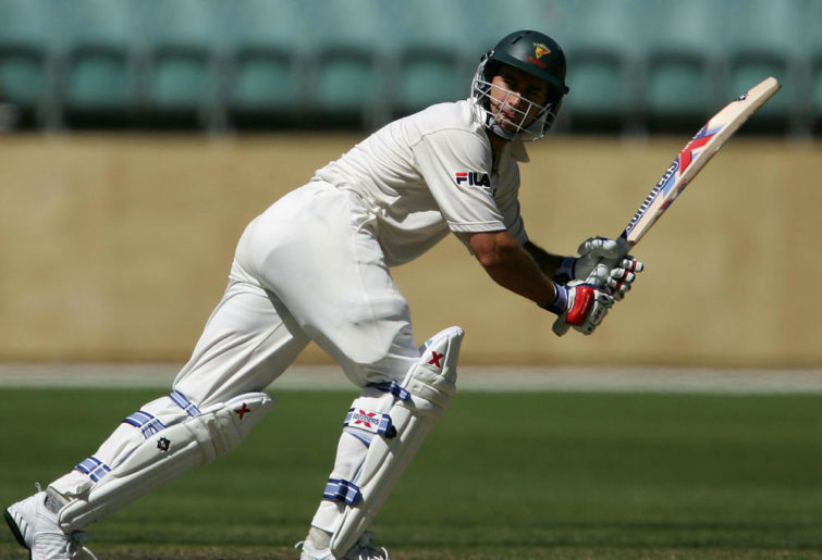 MELBOURNE, AUSTRALIA - FEBRUARY 27: Michael Bevan of Tasmania in action during day four of the Pura Cup match between the Victorian Bushrangers and the Tasmianan Tigers at the Melbourne Cricket Ground on February 27, 2005 in Melbourne, Australia.
