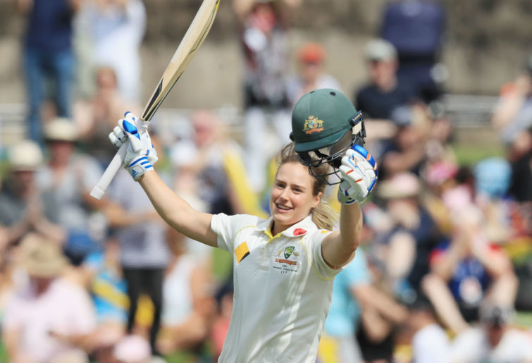 Ellyse Perry celebrates a double century