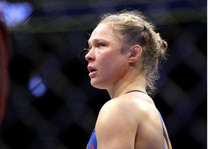 Ronda Rousey looks on at her opponent in the Octagon.