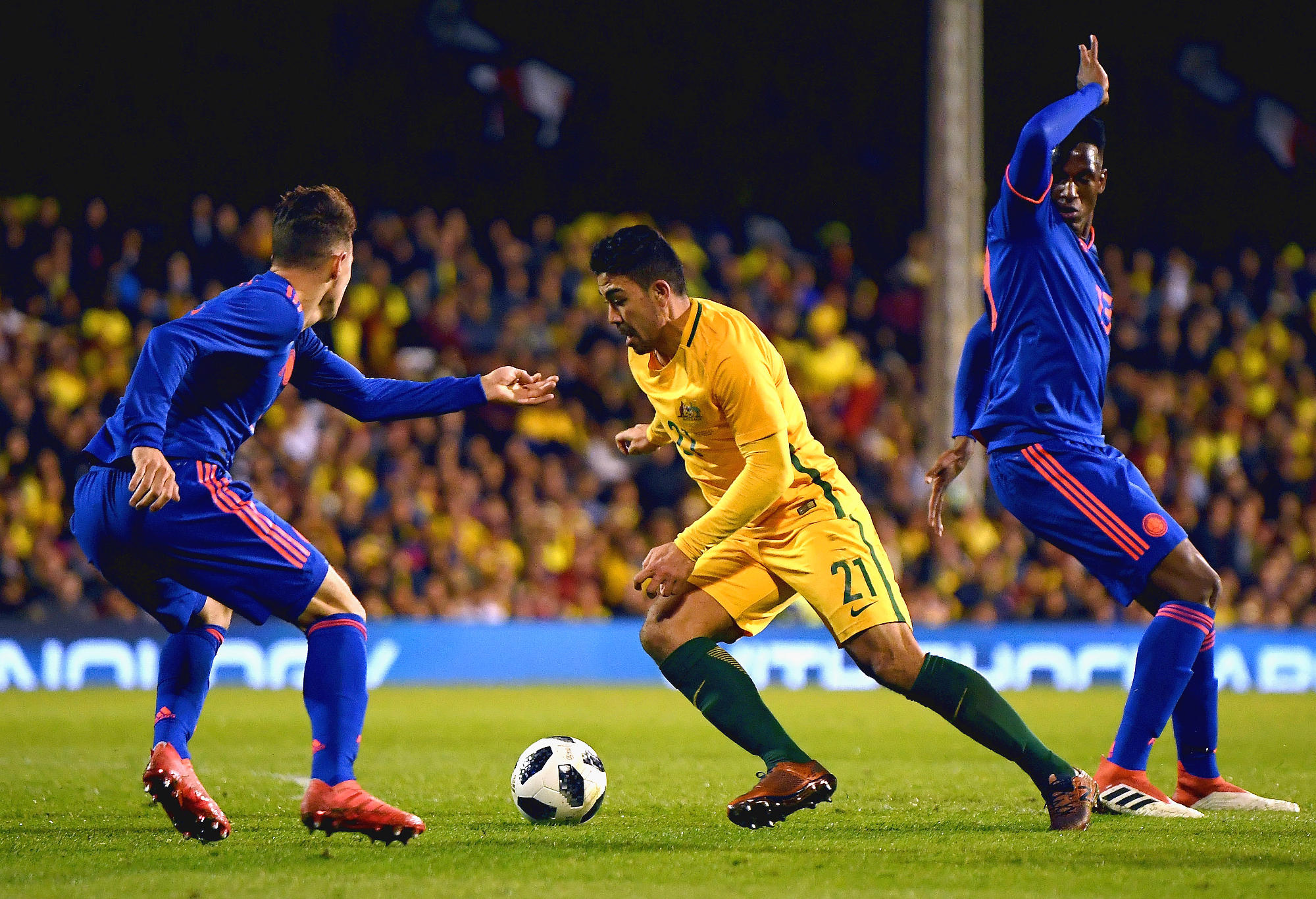 Massimo Luongo takes on the Colombia team