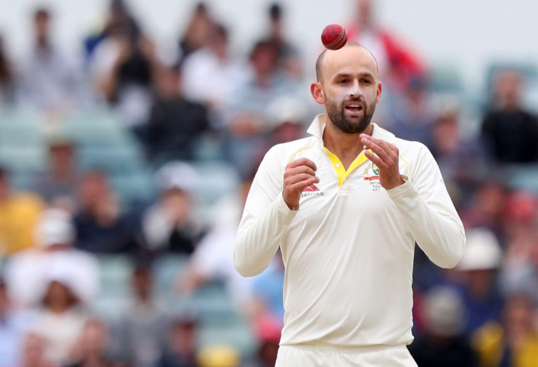 Nathan Lyon of Australia prepares to bowl
