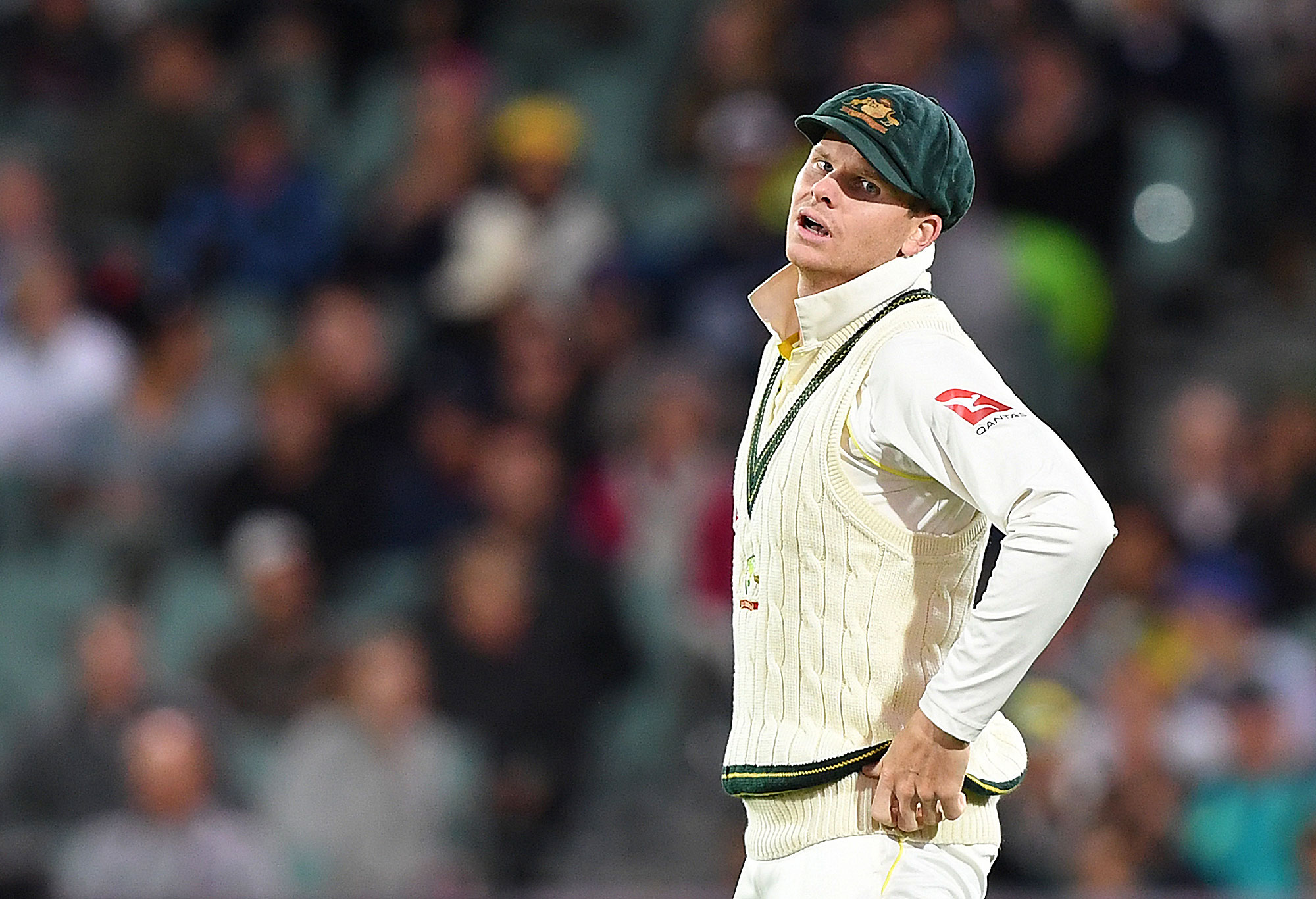 Australian captain Steve Smith reacts following a dropped catch