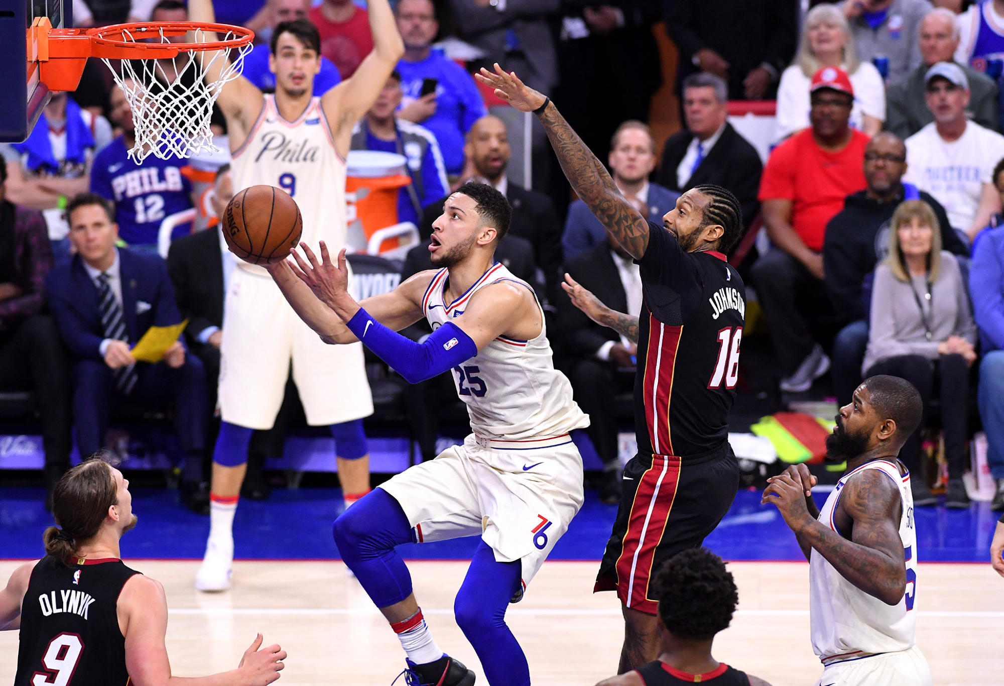 Ben Simmons drives to the rim against James Johnson in Game 2 of the first round of the NBA Playoffs.