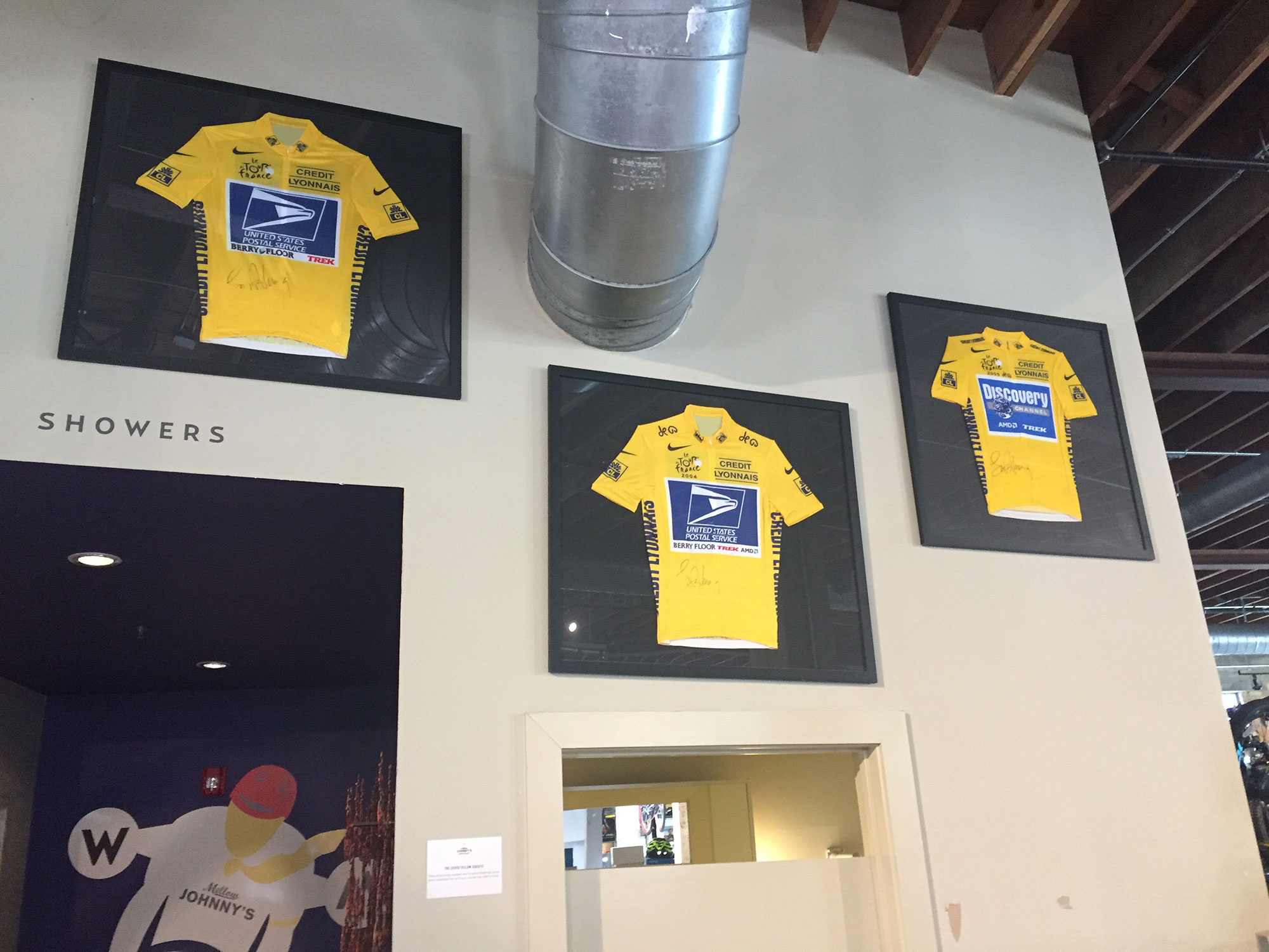 Three of Lance Armstrong's yellow jerseys.