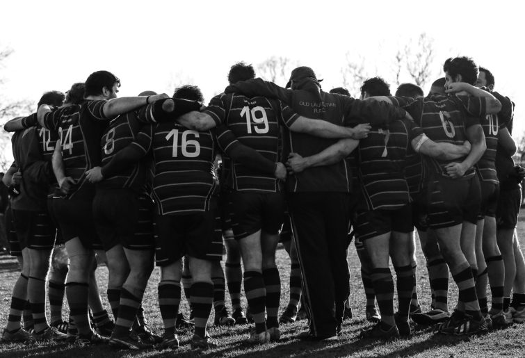 amateur rugby players in black and white