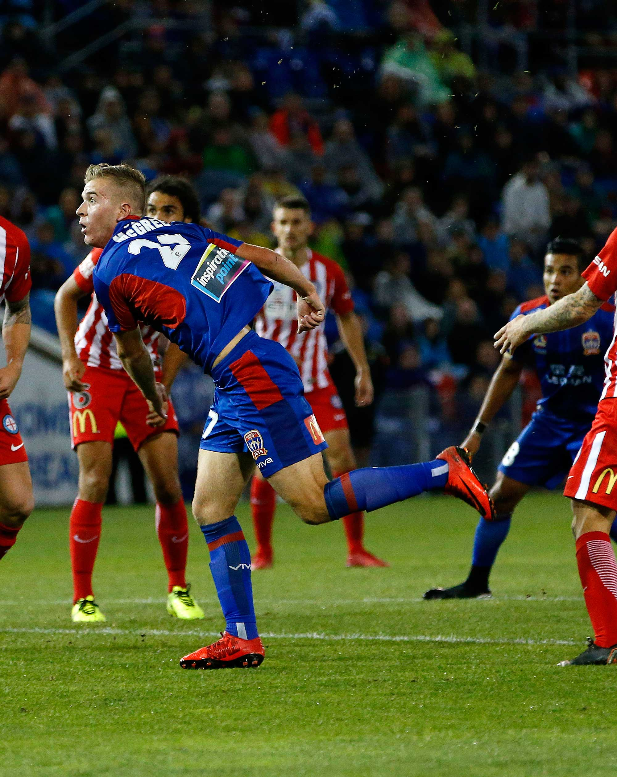 Riley McGree of the Jets scores a second-half goal from a 'scorpion' kick