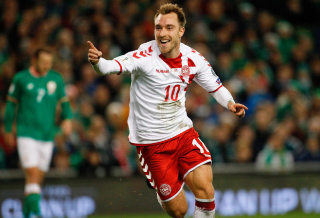 Denmark's Christian Eriksen celebrates after scoring his side's third goal during the World Cup qualifying play off second leg soccer match between Ireland and Denmark at the Aviva Stadium in Dublin.