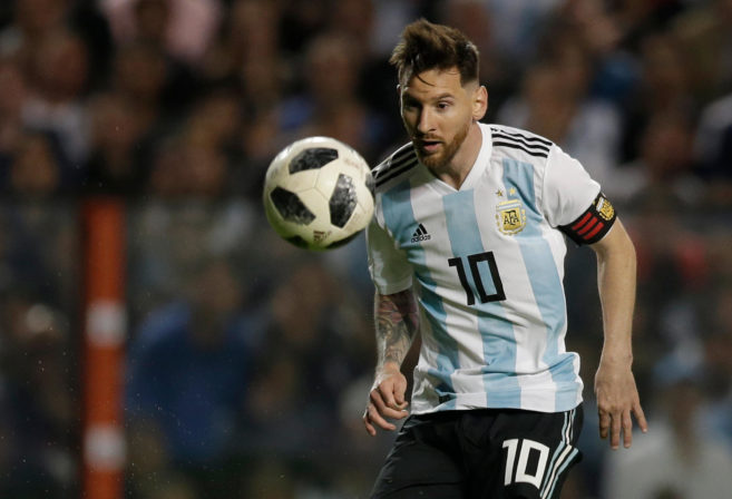 Argentina's Lionel Messi controls the ball during a friendly soccer match between Argentina and Haiti at the Bombonera stadium in Buenos Aires, Argentina, Tuesday, May 29, 2018.
