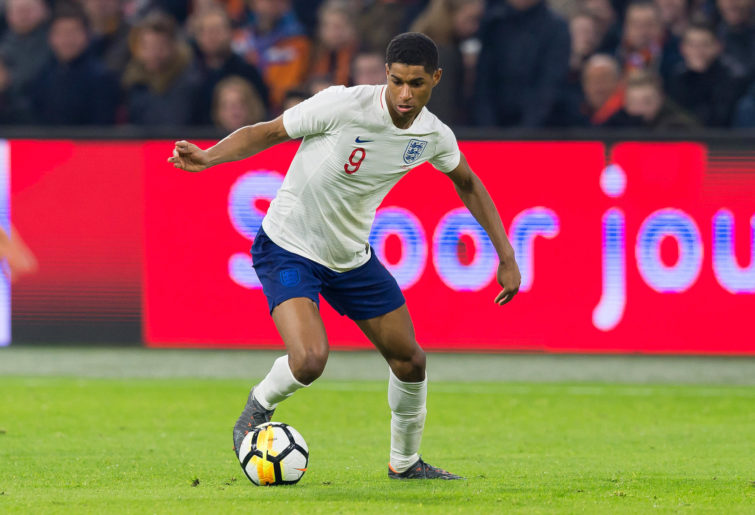 England's Marcus Rashford dribbles the ball.