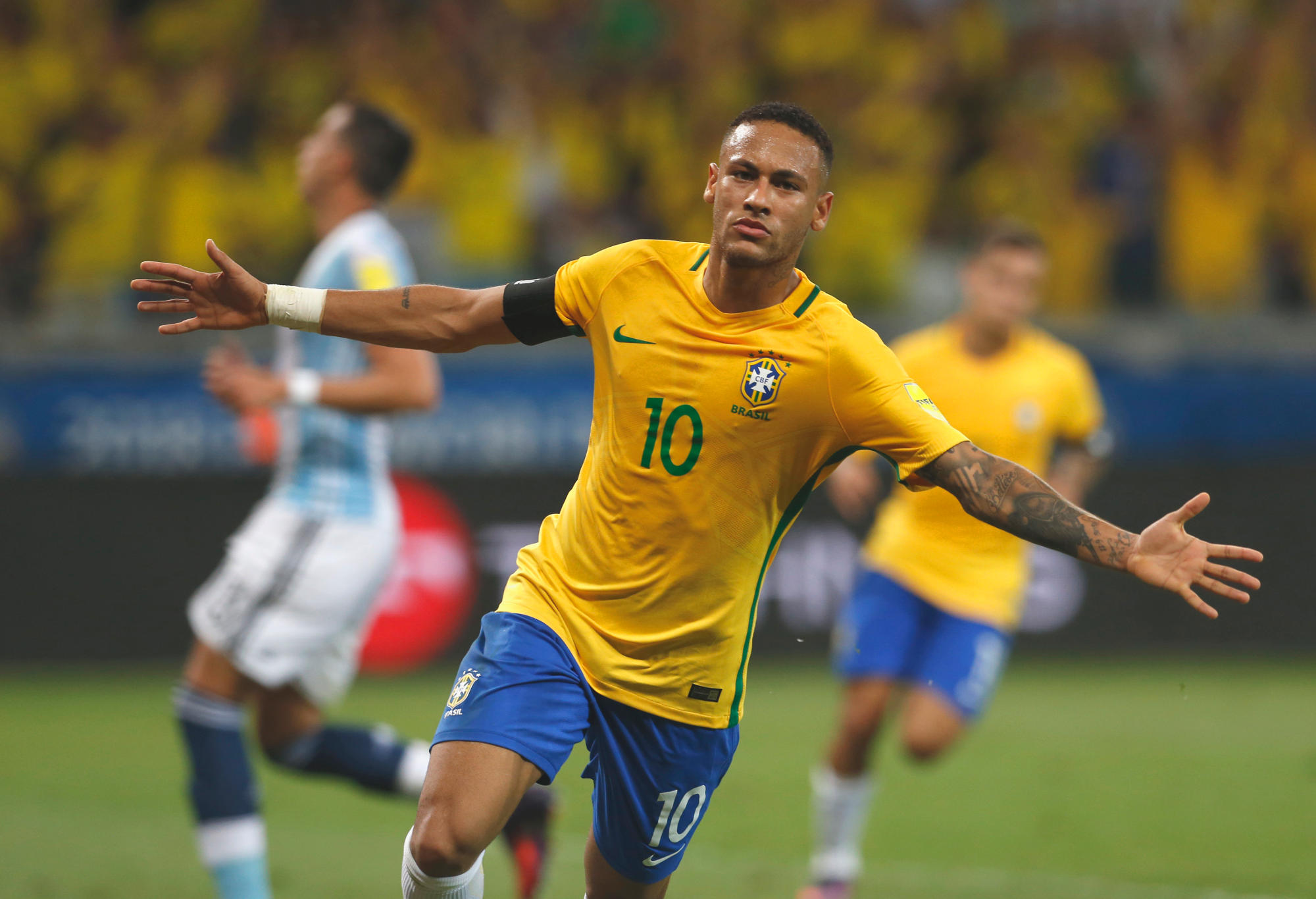 Brazil's Neymar celebrates after scoring his side's second goal against Argentina during a 2018 World Cup qualifying soccer match in Belo Horizonte, Brazil. Brazil's national soccer team is the first to qualify for next year's World Cup. Despite the success, the sporting scene at home is littered with bribes and corruption linked to the World Cup and last year's Rio de Janeiro Olympics.