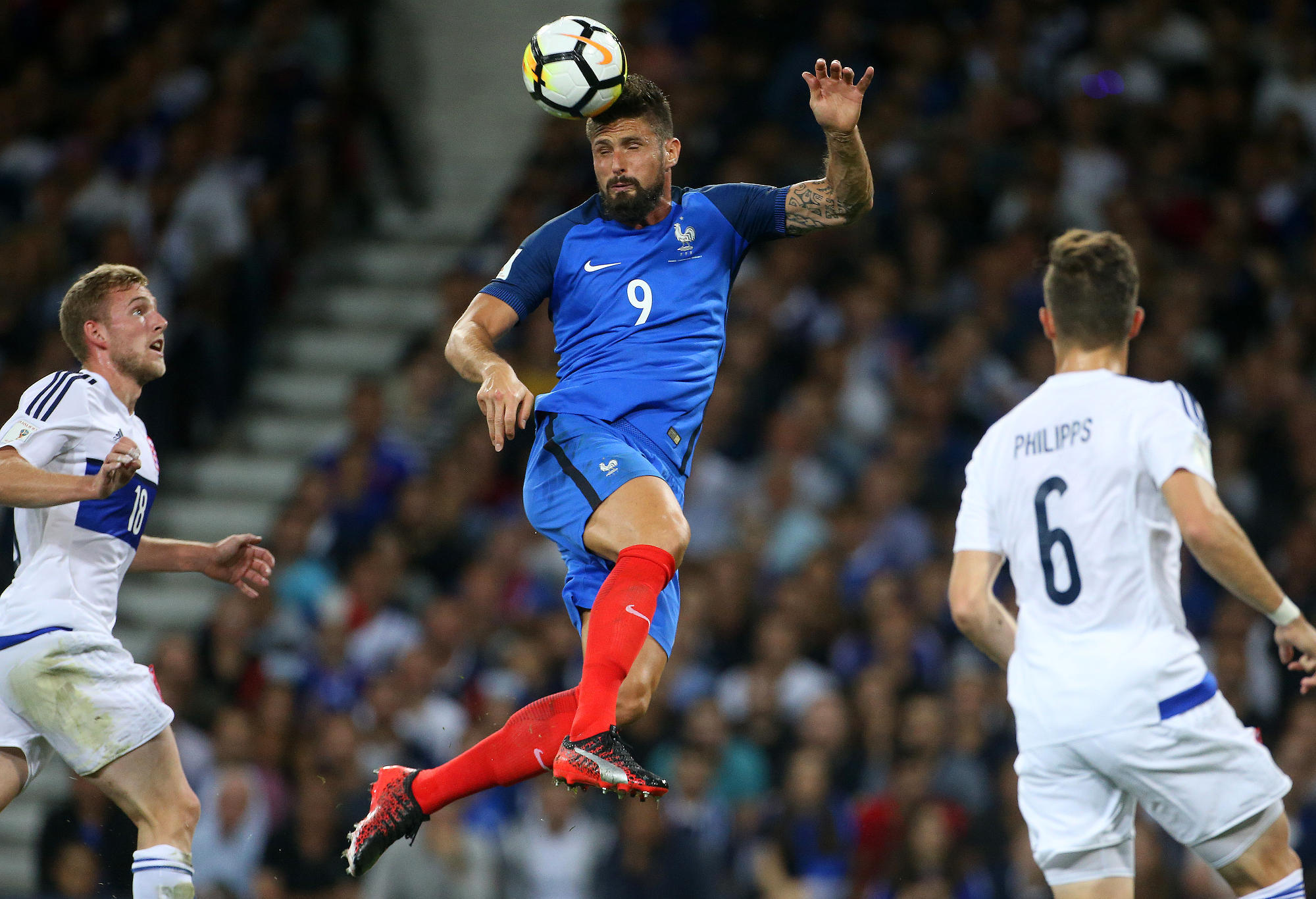France's Oliver Giroud heads the ball.