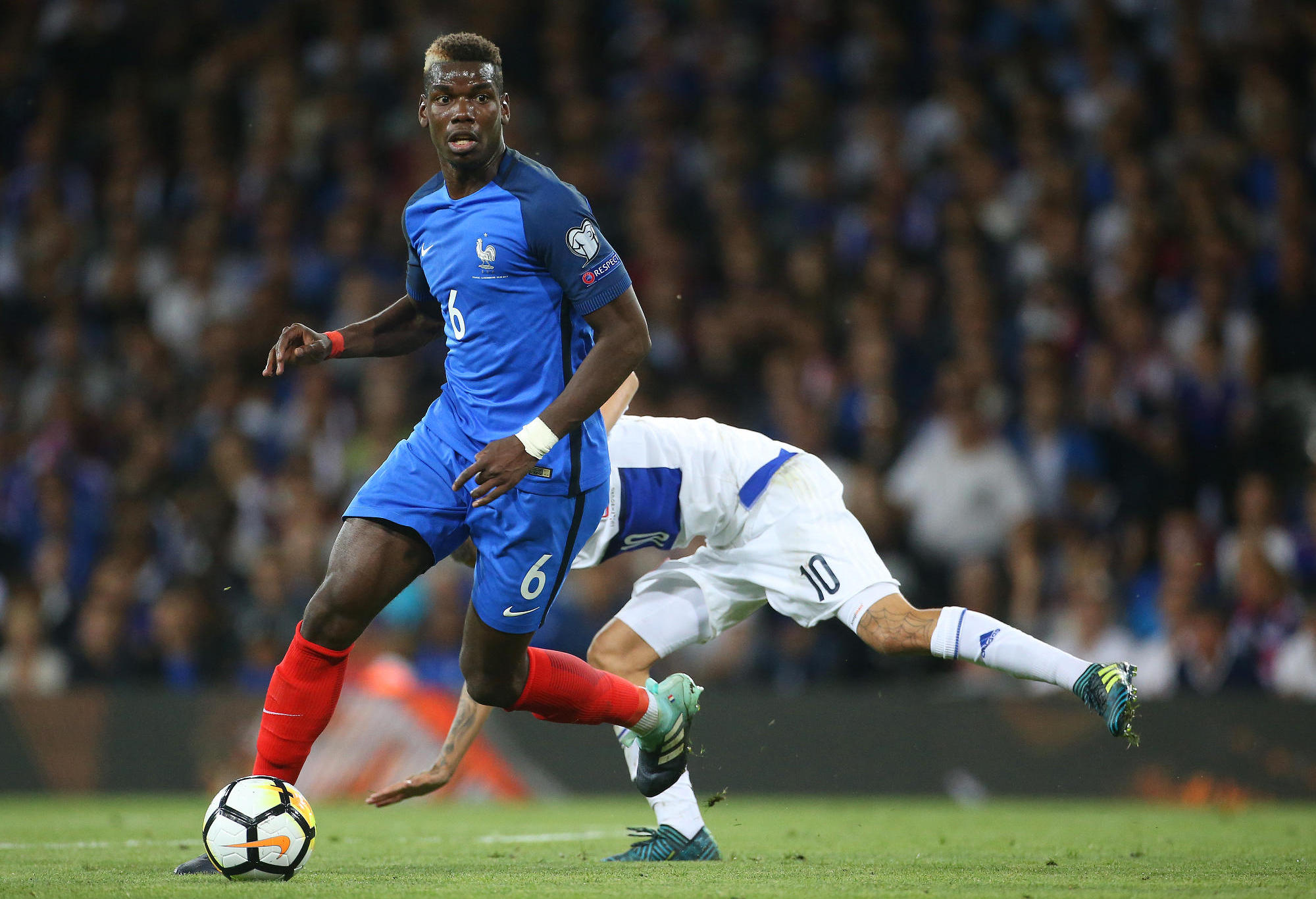 France's Paul Pogba gets past a defender.