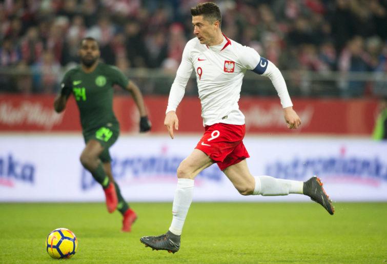 Poland's Robert Lewandowski runs with the ball.