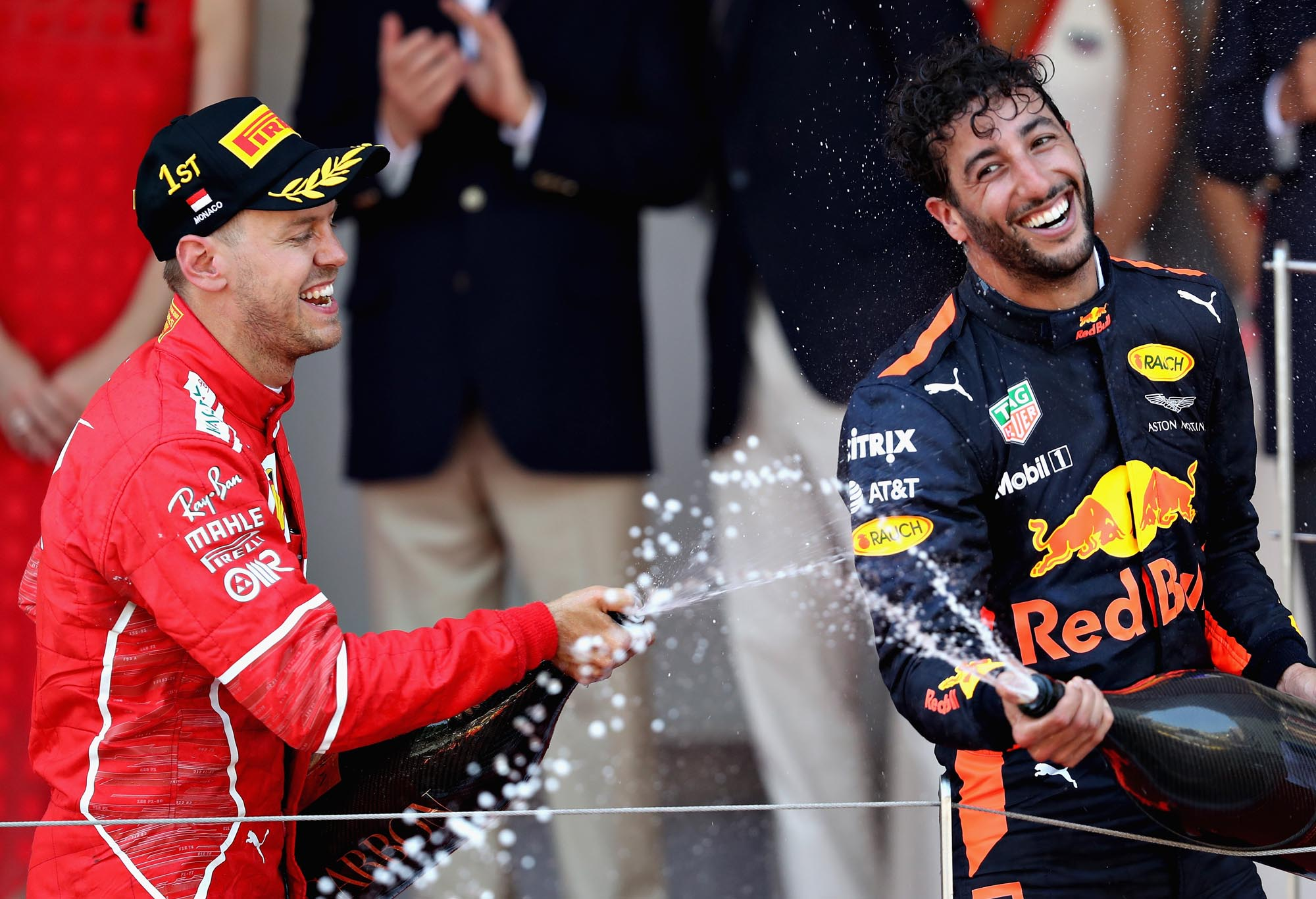 Daniel Ricciardo and Sebastian Vettel celebrate on the 2017 Monaco Grand Prix podium. (Mark Thompson/Getty Images)