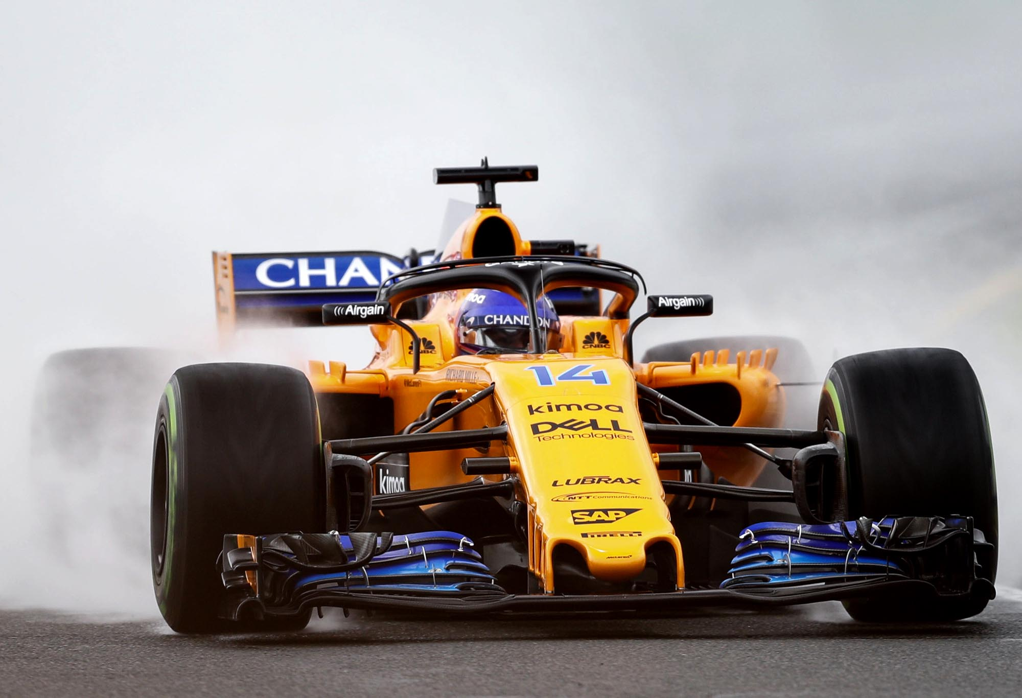 Fernando Alonso drives through a cloud of smoke at the 2018 Australian Grand Prix.