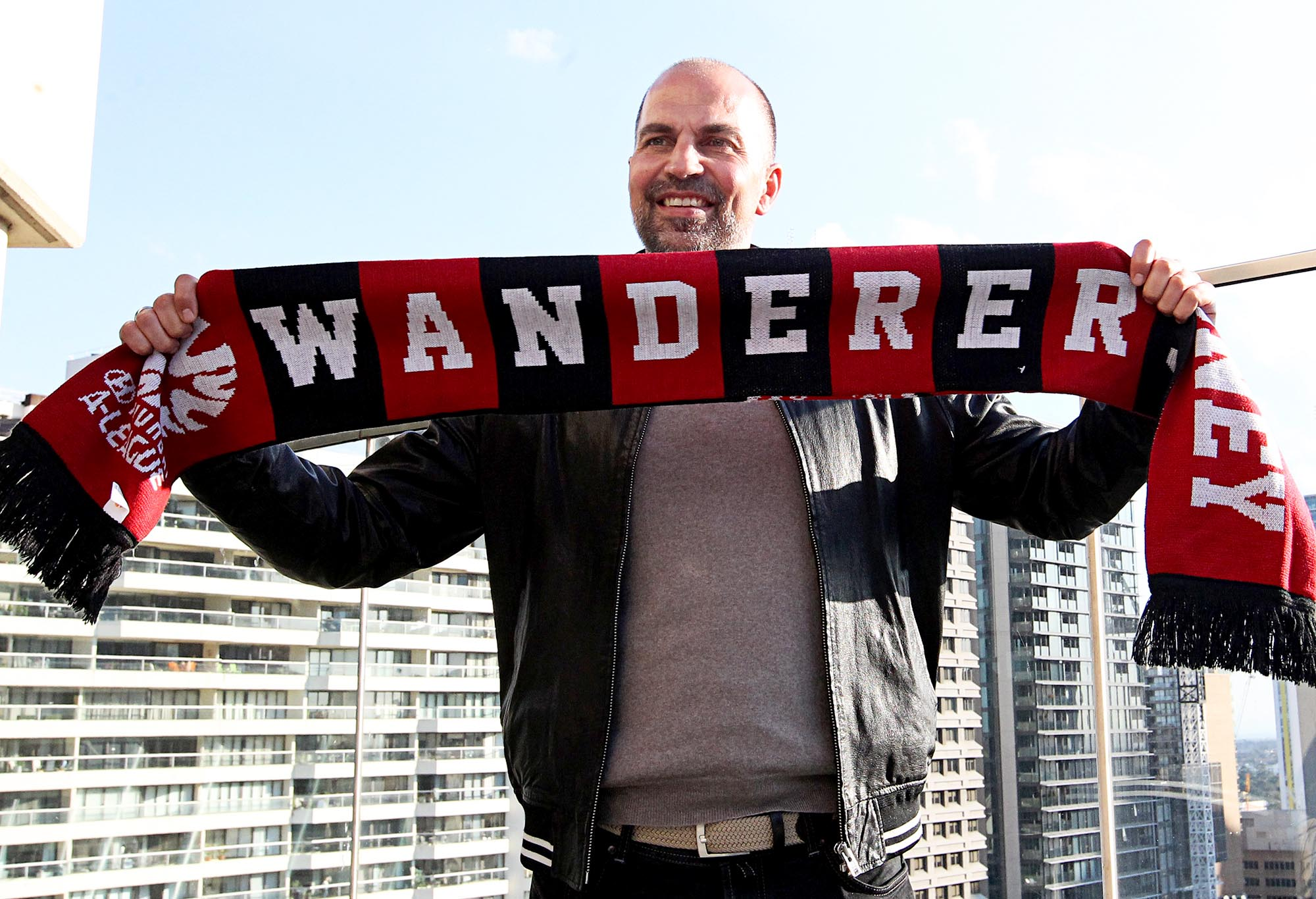 Markus Babbel poses with a Western Sydney Wanderers scarf.