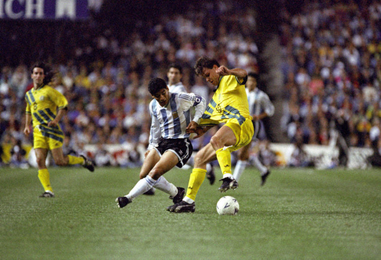 Diego Maradona fights for the ball against Australia
