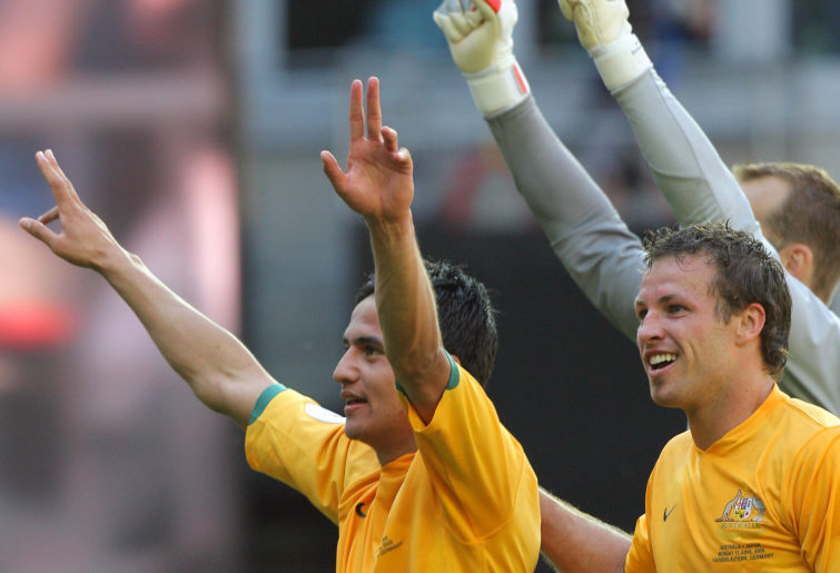 Tim Cahill, Lucas Neill and Mark Schwarzer (R-behind) celebrate their victory over Japan
