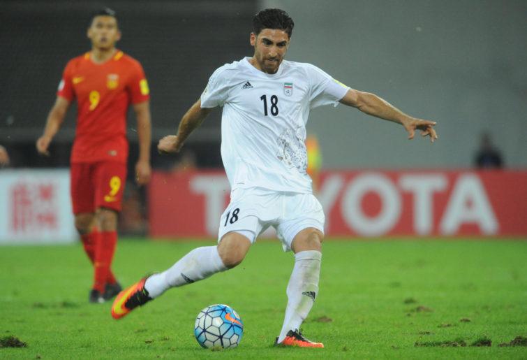 Alireza Jahanbakhsh drives the ball against China.