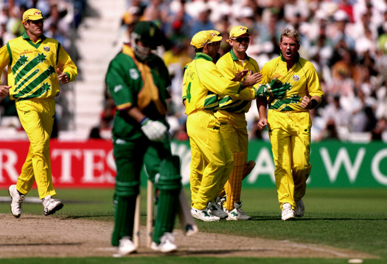 Australia's Shane Warne (right) encourages South Africa's Herschelle Gibbs (left) to leave the field after dismissing him.