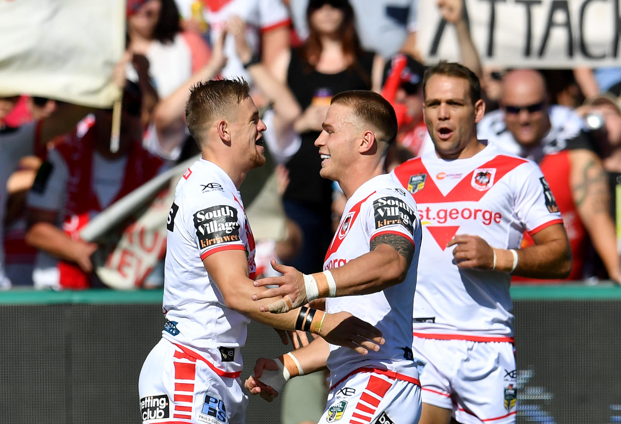 Euan Aitken and Matt Dufty celebrate a try.