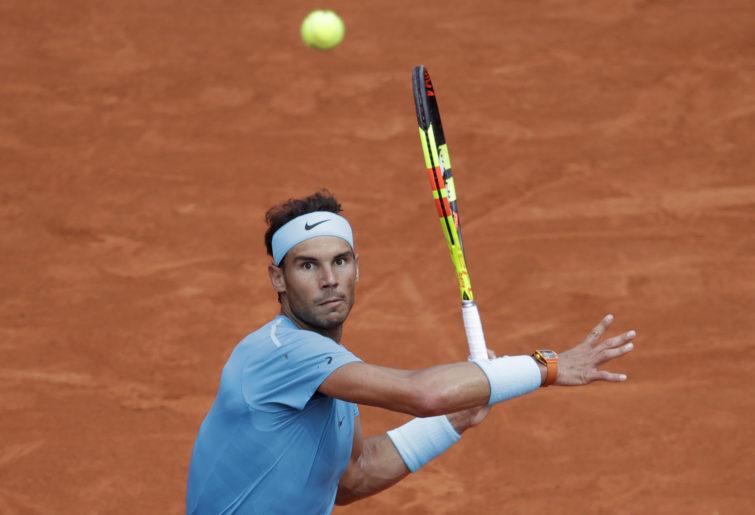 Rafael Nadal returns a shot