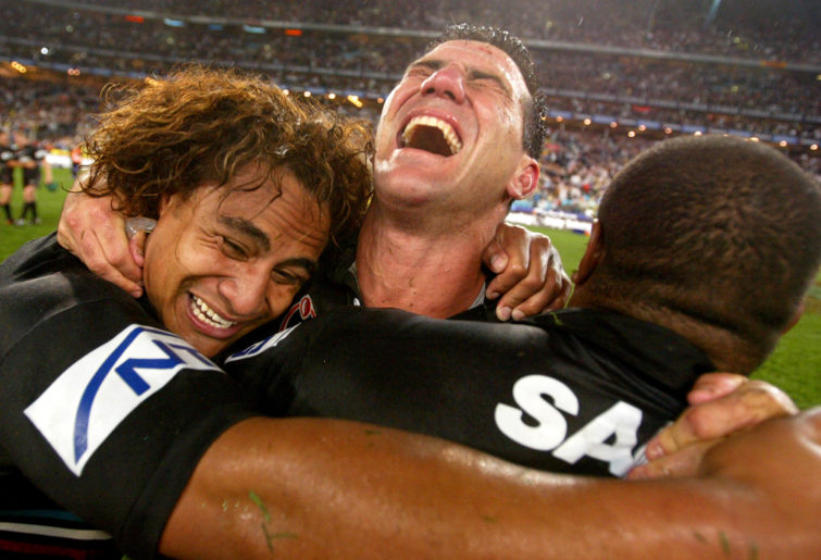 Joe Galuvao #11, Scott Sattler #13 and Rhys Wesser #1 of the Panthers celebrate victory during the NRL Grand Final between the Sydney Roosters and the Penrith Panthers at Telstra Stadium October 5, 2003 in Sydney, Australia. Penrith won 18-6.