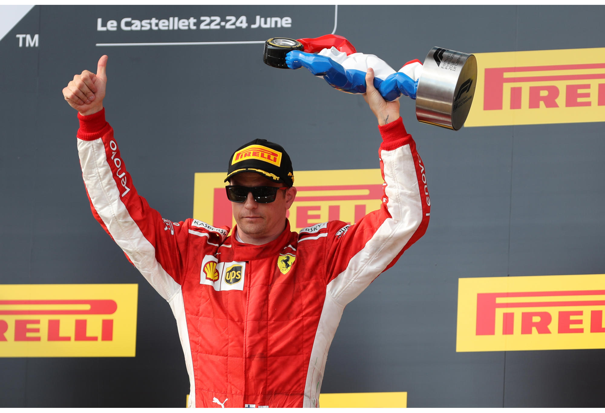 Ferrari's Kimi Raikkonen celebrates on the podium
