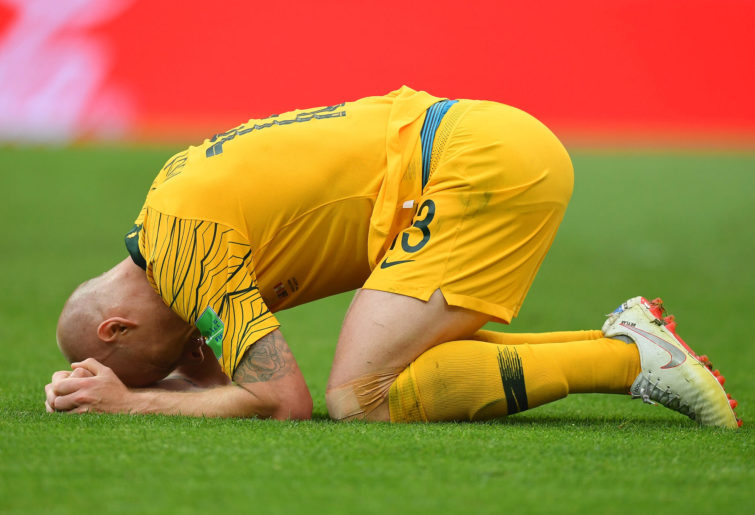 Aaron Mooy of Australia looks dejected following his side's defeat at the World Cup