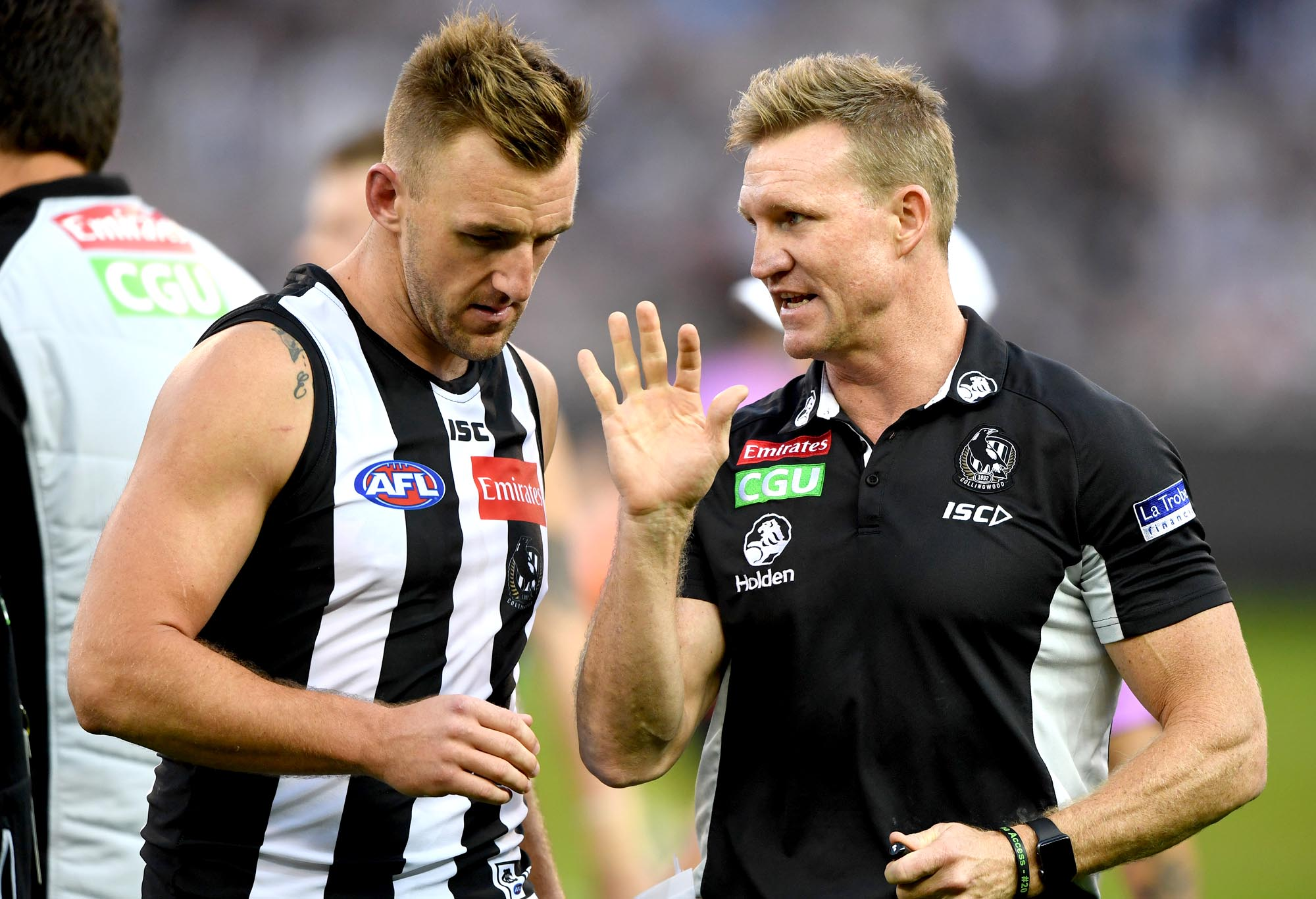 Collingwood's Lynden Dunn talks to coach Nathan Buckley