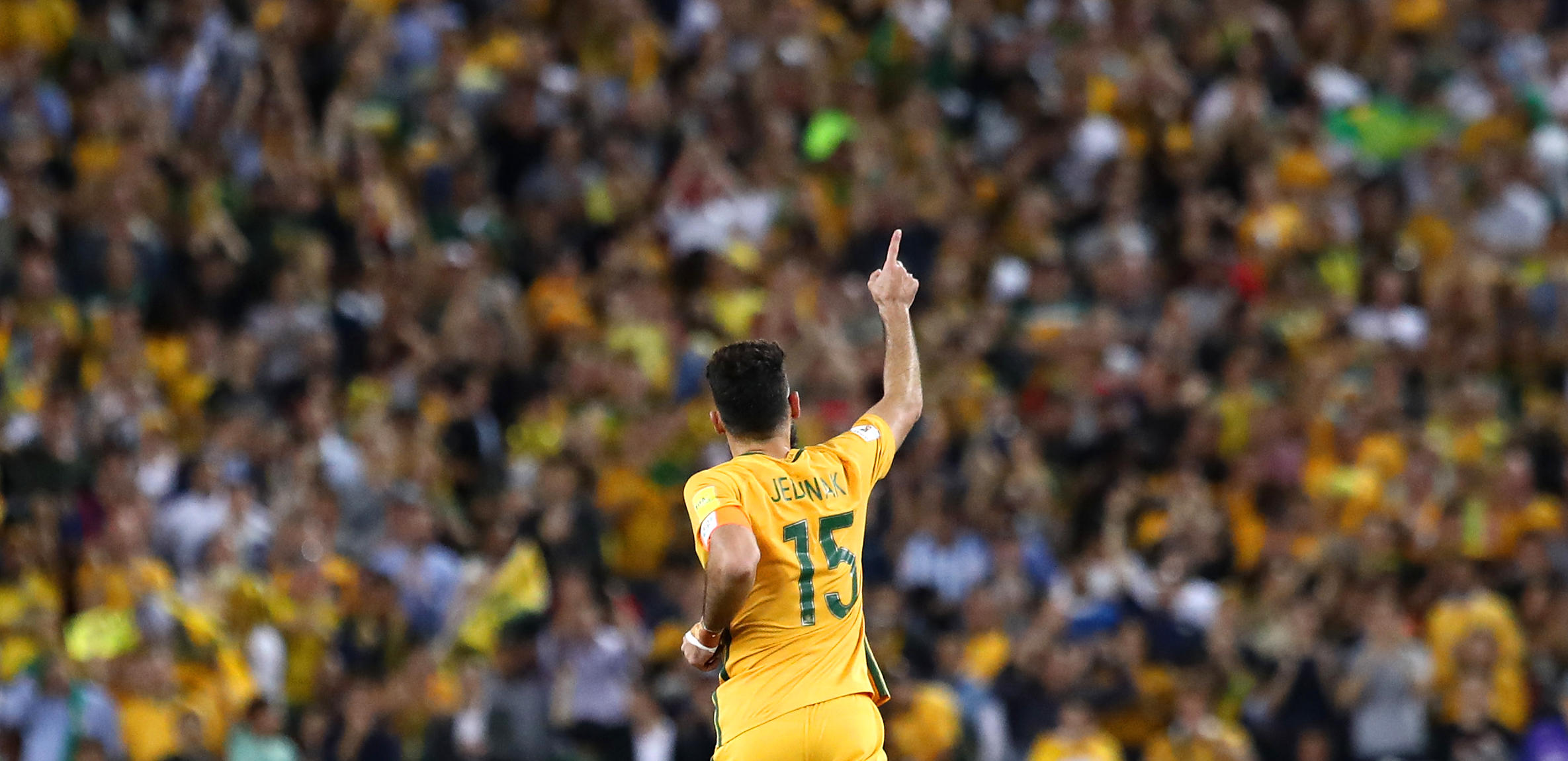 Mile Jedinak of Australia celebrates scoring a goal
