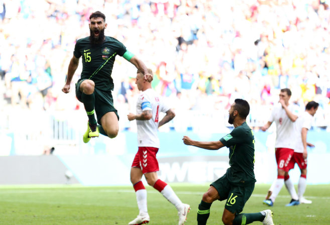 Mile Jedinak celebrates after scoring for the Socceroos