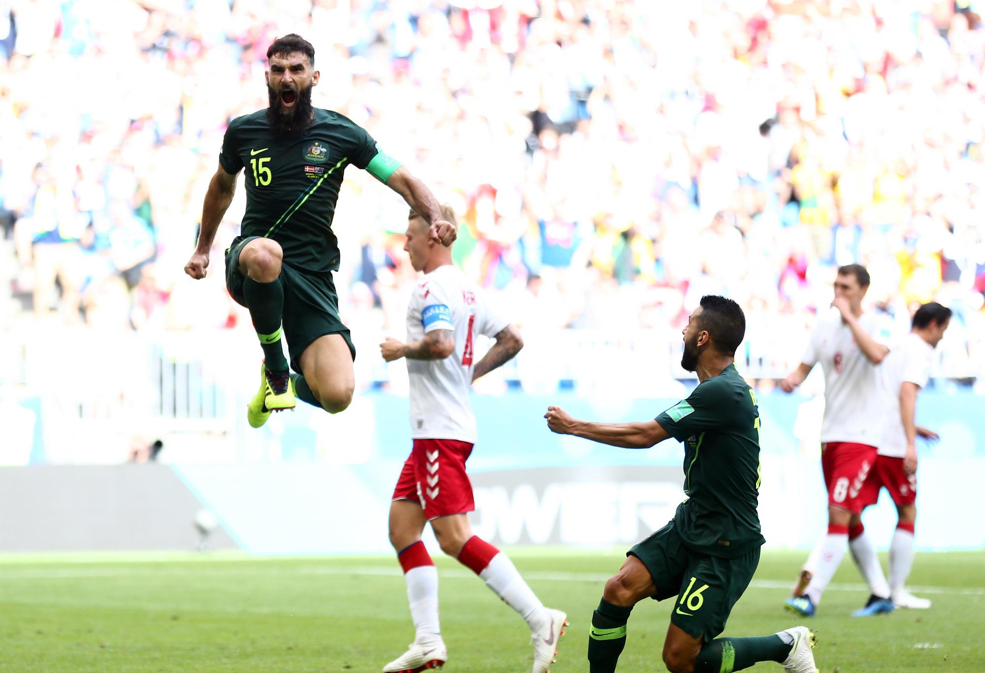 Mile Jedinak celebrates after scoring for the Socceroos