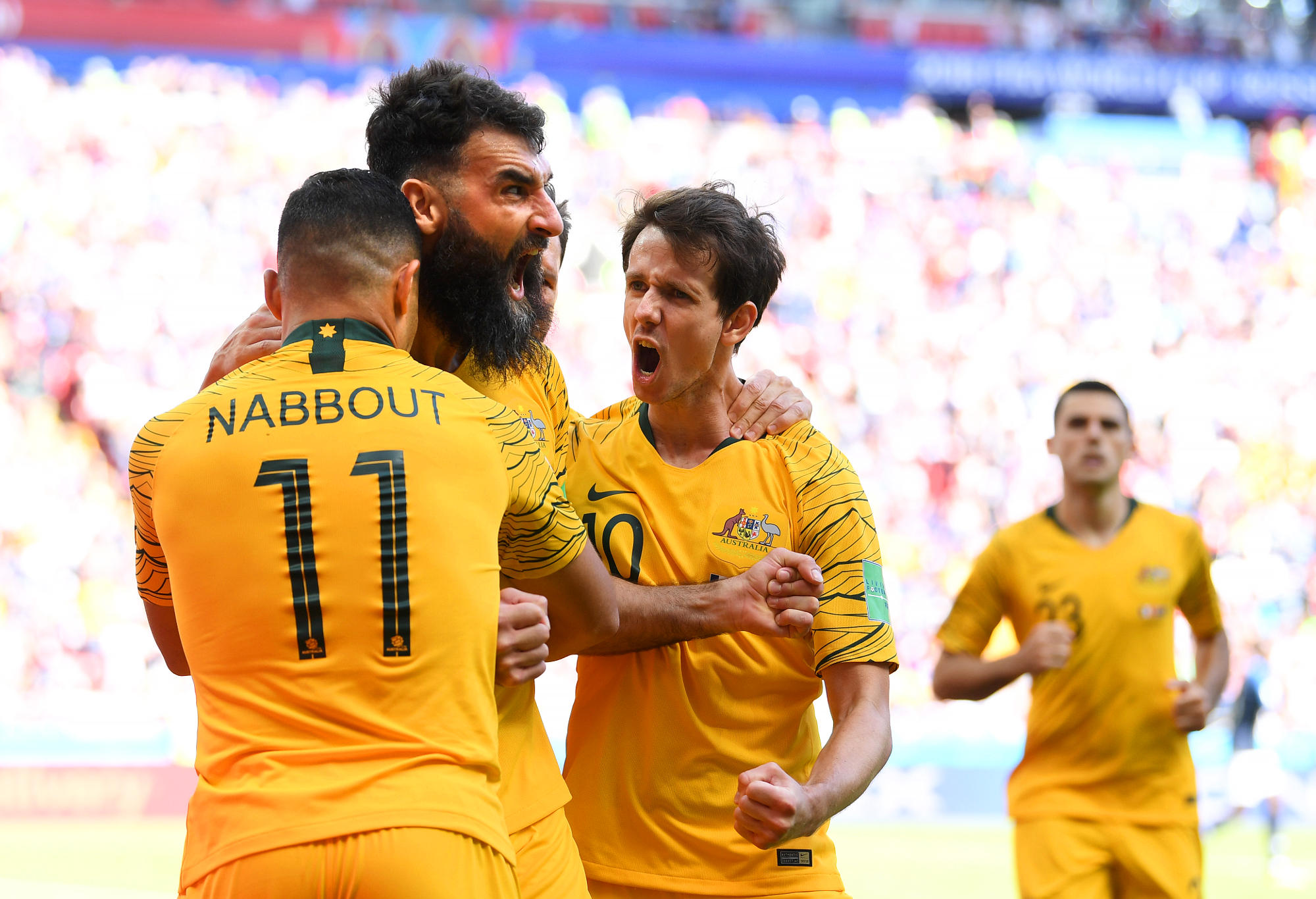 Mile Jedinak of Australia celebrates scoring a goal at the World Cup