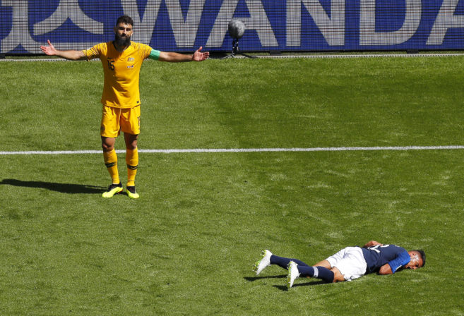Mile Jedinak reacts with frustration after giving away a foul