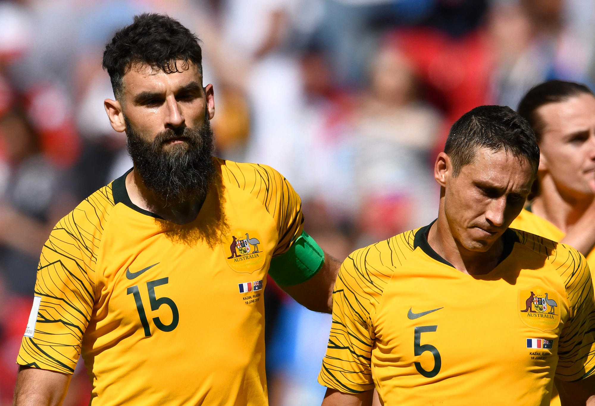 Socceroos Mile Jedinak and Mark Milligan react after losing a World Cup game