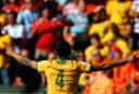 Tim Cahill celebrates scoring a goal