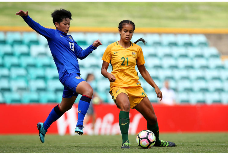 Mary Fowler of Australia competes for the ball against Thailand.